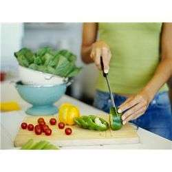 Woman chopping vegetables for salad.JPG